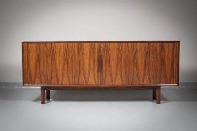 A ROSEWOOD SIDEBOARD by Arne Vodder  at deVeres Auctions