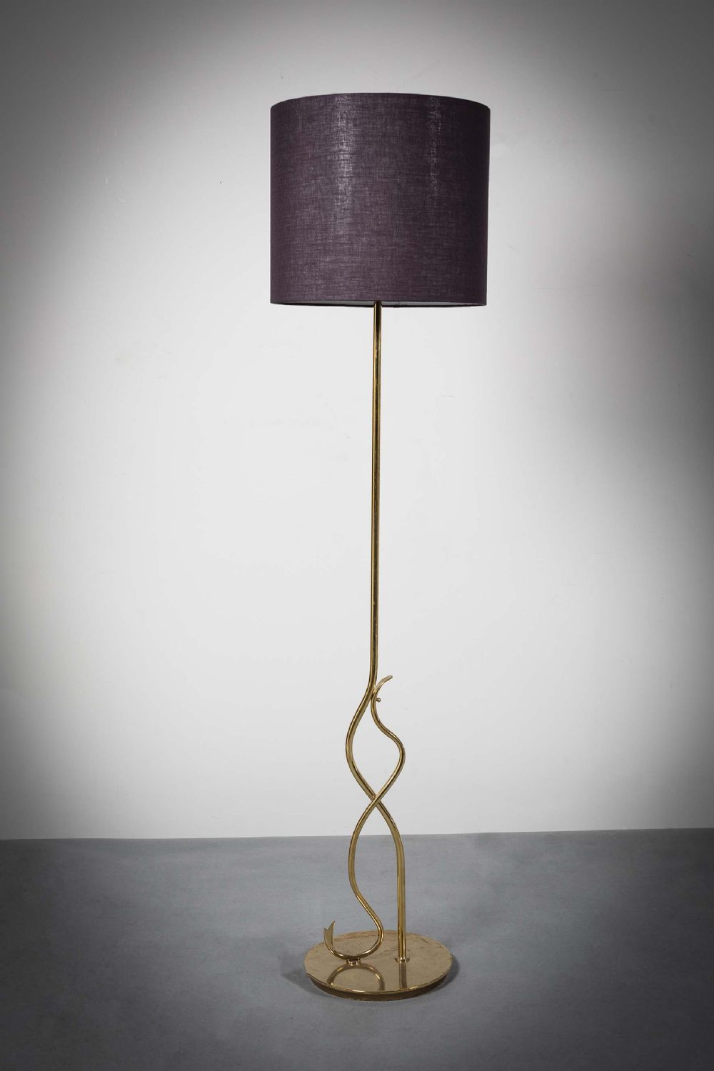 A GILT STANDARD LAMP at deVeres Auctions